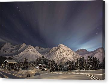 Winterevening In The Mountains Canvas Print by Ralf Eisenhut