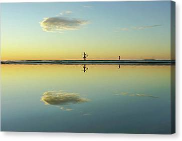 Woman And Cloud Reflected On Beach Lagoon At Sunset Canvas Print