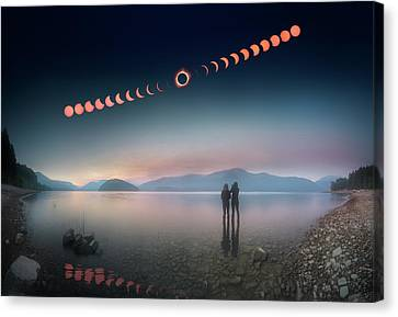 Woman And Girl Standing In Lake Watching Solar Eclipse Canvas Print