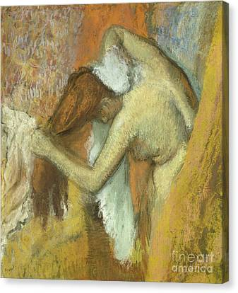 Woman At Her Toilette Canvas Print by Edgar Degas