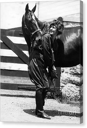 Woman Checking Horses Hoof, C.1900-10s Canvas Print by H. Armstrong Roberts/ClassicStock
