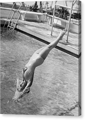 Woman Doing A Back Dive Canvas Print by Underwood Archives