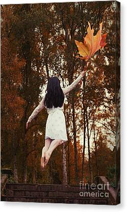 Floating Girl Canvas Print - Woman Floating Away With Autumn Leaf by Amanda Elwell