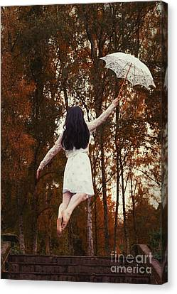 Floating Girl Canvas Print - Woman Floating Away With Parasol by Amanda Elwell