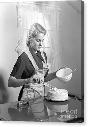 Sweet Touch Canvas Print - Woman Frosting A Cake, C.1940s by H. Armstrong Roberts/ClassicStock