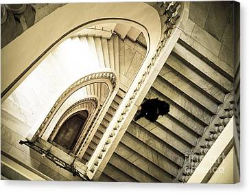 Woman Going Down At Staircase Canvas Print by Perry Van Munster