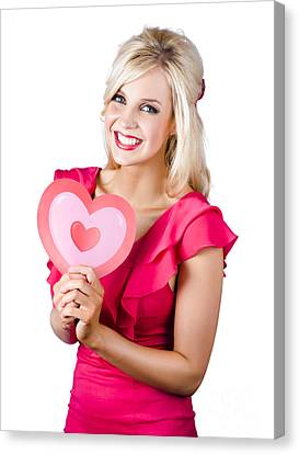 Woman Holding A Pink Heart-shape Canvas Print by Jorgo Photography - Wall Art Gallery