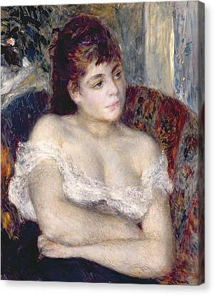 Woman In An Armchair Canvas Print by Pierre Auguste Renoir