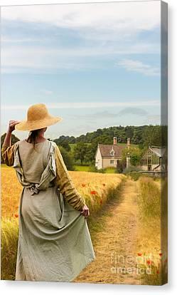 Woman In Field Canvas Print by Amanda Elwell