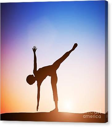 Woman In Half Moon Yoga Pose Meditating At Sunset Canvas Print by Michal Bednarek