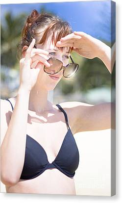 Woman Looking Over Sunglasses Canvas Print by Jorgo Photography - Wall Art Gallery