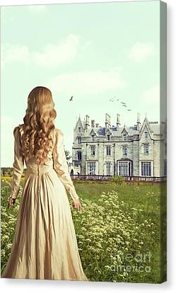 Woman Overlooking Mansion Canvas Print by Amanda Elwell