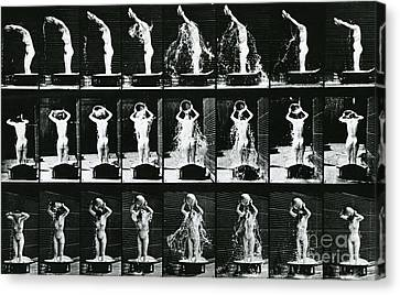 Woman Pouring A Basin Of Water Over Her Head Canvas Print by Eadweard Muybridge