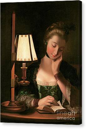 Woman Reading By A Paper Bell Shade Canvas Print by Henry Robert Morland