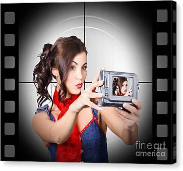 Woman Recording A Movie Using Video Camera Canvas Print