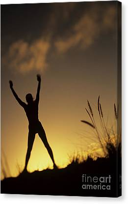 Woman Stretching On A Mountain Canvas Print by Dana Edmunds - Printscapes