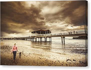 Woman Walking Dog On Stormy Beach Canvas Print