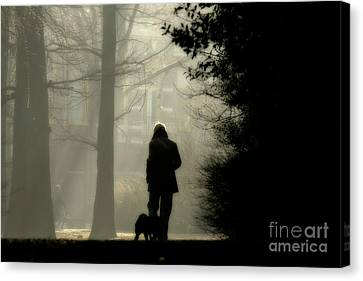 Canvas Print featuring the photograph Woman Walking Dog by Patricia Hofmeester
