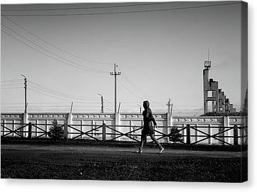 Canvas Print featuring the photograph Woman Walking In Industry by John Williams