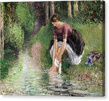 Woman Washing Her Feet In A Brook Canvas Print by Camille Pissarro