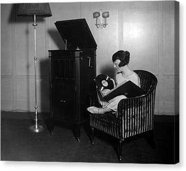 Woman With Record Albums And Victrola Canvas Print by Everett