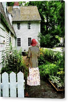 Woman With Striped Jacket And Flowered Skirt Canvas Print by Susan Savad