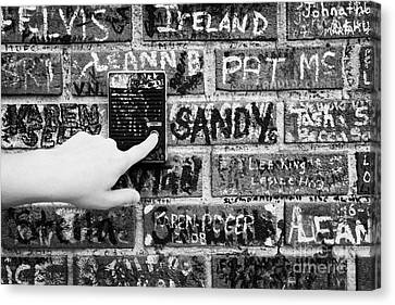 Womans Hand Pushing Old Intercom Button On Wall Covered In Graffiti Outside Graceland Memphis Canvas Print by Joe Fox