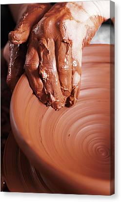 Women Hands. Potter At Work. Creating Dishes. Potter's Wheel. Dirty Hands In The Clay And The Potter Canvas Print by Alim Yakubov