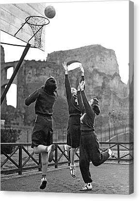 Women Playing Basketball Canvas Print by Underwood Archives