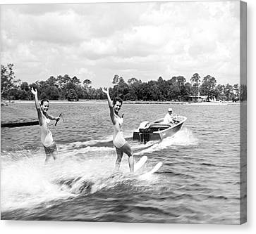 Women Water Skiers Waving Canvas Print by Underwood Archives
