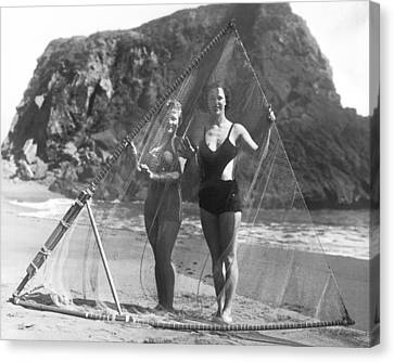 Women With Surf Fishing Net Canvas Print by Underwood Archives