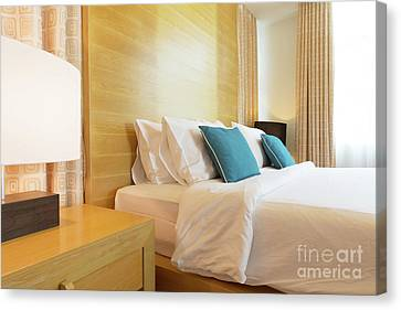 Canvas Print featuring the photograph Wood Bed by Atiketta Sangasaeng