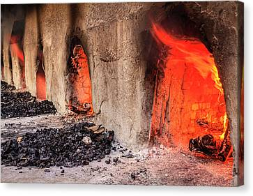 Wood Burning Ovens Canvas Print by Alexey Stiop