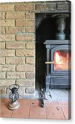 Wood Burning Stove Canvas Print by Tom Gowanlock