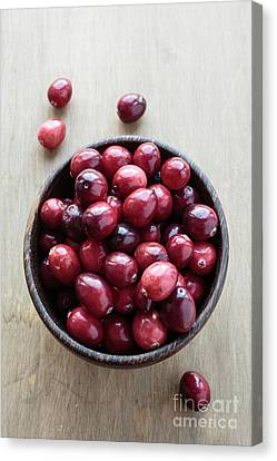 Wooden Bowl Of Ripe Red Cranberries Canvas Print by Edward Fielding