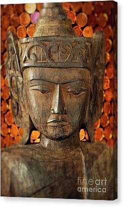 Wooden Buddha Canvas Print by John Greim