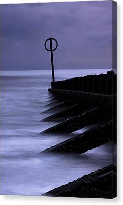 Wooden Groynes Of Aberdeen Scotland Canvas Print by Gabor Pozsgai