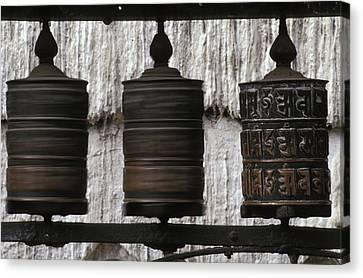Tibetan Canvas Print - Wooden Prayer Wheels by Sean White