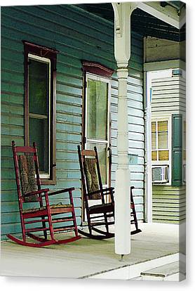 Wooden Rocking Chairs On Porch Canvas Print by Susan Savad