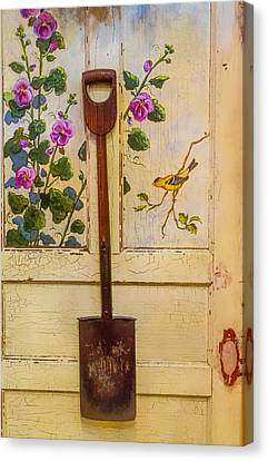 Wooden Shovel On Painted Door Canvas Print by Garry Gay