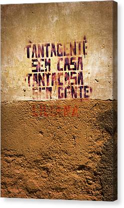 Industrial Background Canvas Print - Words Painted On Yellow Wall by Carlos Caetano