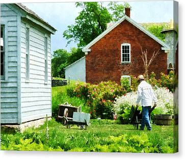 Working On The Farm Canvas Print by Susan Savad