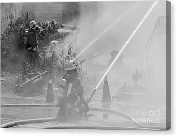 Working The Fire Canvas Print by James Brown