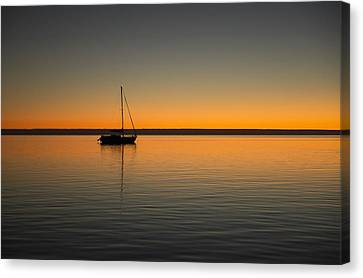 Yacht At Sunset Canvas Print by Gary Wright