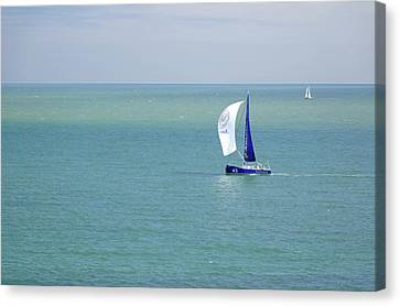 Yachts Sailing In Ventnor Bay Canvas Print by Rod Johnson