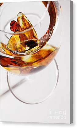 Canvas Print featuring the photograph Yellow Amber Stones In A Glass. by Andrey  Godyaykin
