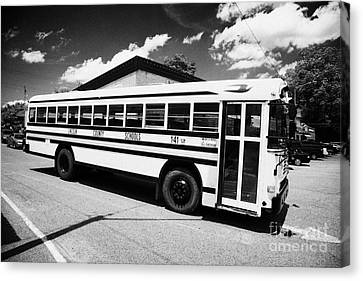 yellow american bluebird school bus in Lynchburg tennessee usa Canvas Print by Joe Fox