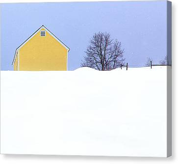 Yellow Barn In Snow Canvas Print by John Vose