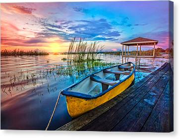 Yellow Canoe Canvas Print by Debra and Dave Vanderlaan