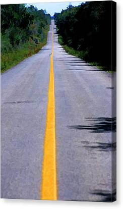 Yellow Dividing Line Marking An Empty Road Between Uxmal And Kabah Canvas Print by Sami Sarkis